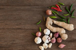 top-view-cooking-ingredients-are-onion-chilli-ginger-garlic-wooden-background-thailand-spices_125071-177